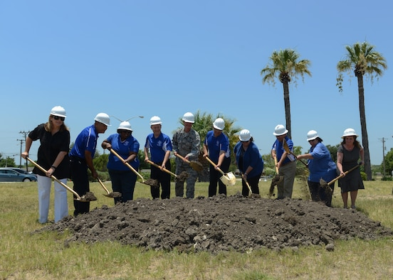 Members of the San Felipe Del Rio Consolidated Independent School District and local civic leaders join U.S. Air Force Col. Thomas Shank in breaking the ground for the future Science, Technology, Mathematics and Engineering Magnet Elementary School at Laughlin Air Force Base,Tx., June 23, 2017. Building this school base will allow students to have direct access to mentors that work in the STEM career field.
