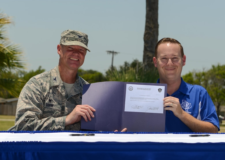 San Felipe Del Rio Consolidated Independent School District Board of Trustees' President Mr. Joshua Overfelt and U.S. Air Force Col. Thomas Shank pose after a symbolic signing for this project at Laughlin Air Force Base, Tx., June 27, 2017. Through collaborative efforts, the base and city have shared both resources and expenses to facilitate the school's construction.