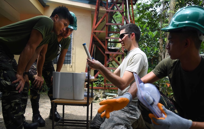 U.S. Air Force Staff Sgt. Alexander Kendrick, engineering plumber with the 354th Civil Engineer Squadron, Eielson Air Force Base, Alaska, middle, provides plumbing installation guidance to Armed Forces of the Philippines members during Pacific Angel (PACANGEL) 2017 in Bogo City, Northern Cebu Province, Philippines, June 24, 2017. Efforts undertaken during PACANGEL help multilateral militaries in the Pacific improve and build relationships across a wide spectrum of civic engagements, which bolsters each nation's capacity to respond and support future humanitarian assistance and disaster relief operations. (U.S. Air Force photo/Tech. Sgt. Jeff Andrejcik)