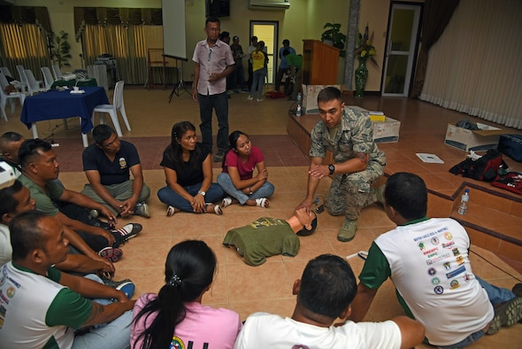 U.S. Air Force Senior Airman Alexander Howe, medical technician with the 152nd Nevada Air National Guard, demonstrates cardiopulmonary resuscitation to local Filipino first responders during Pacific Angel 2017 in Northern Cebu Province, Philippines, June 24, 2017. Subject matter expert exchanges like this promote regional military-civilian-nongovernmental organization cooperation and interoperability. (U.S. Air Force photo/Tech. Sgt. Jeff Andrejcik)