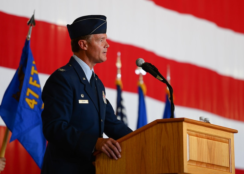 Outgoing commander, U.S. Air Force Col. Thomas Shank gives remarks during the 47th Flying Training Wing's change of command ceremony at Laughlin Air Force Base, Tx., June 28, 2017.  Col. Shank, a command pilot with over 3,000 flight hours, directed the Air Force's largest training operation, which exceeds over 80,000 flying hours and 54,000 sorties.