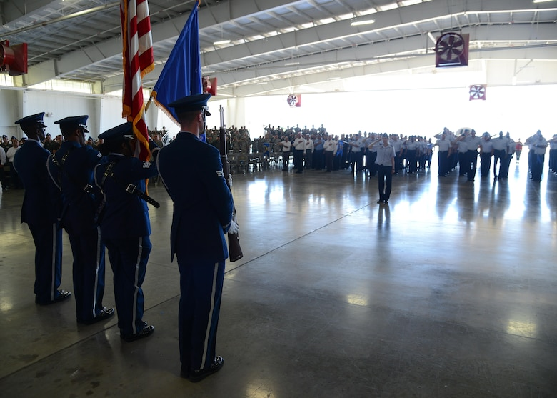 Laughlin Air Force Base's Honor Guard stands at attention during the 47th Flying Training Wing change of command ceremony at Laughlin Air Force Base, Tx., June 28, 2017.  The Honor Guard, along with attendees and distinguished visitors, helped Laughlin welcome its incoming commander, U.S. Air Force Col. Charles Velino.