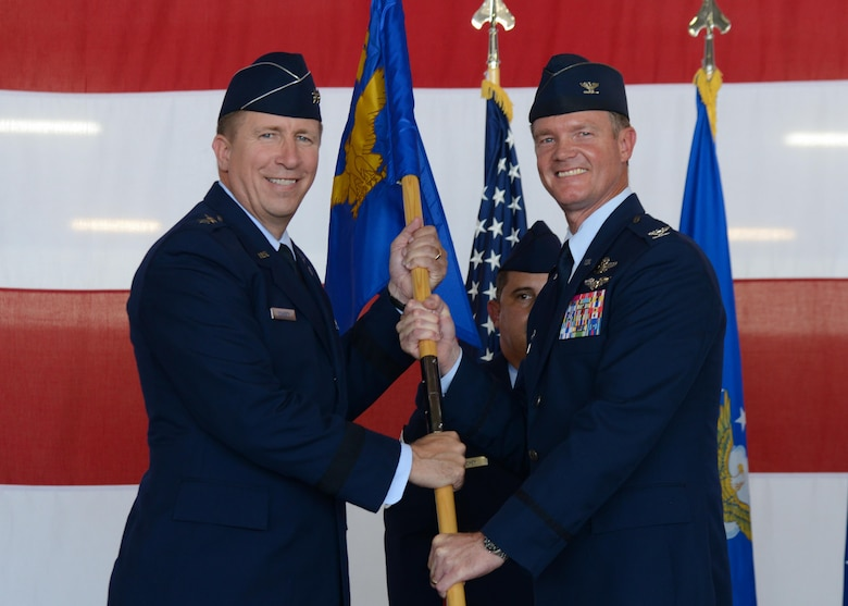 U.S. Air Force Col. Thomas Shank, outgoing 47th Flying Training Wing commander, relinquishes command to Maj. Gen. Patrick Doherty, 19th Air Force commander, during the wing's change of command ceremony at Laughlin Air Force Base, Tx., June 28, 2017. The passing of the guideon symbolizes the ceremonious passing of responsibility and command from one party to another.