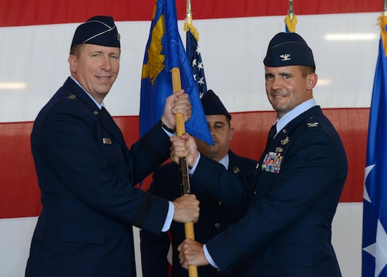 U.S. Air Force Major General Patrick Doherty, 19th Air Force commander, presents the guideon to Col. Charles Velino, incoming 47th Flying Training Wing commander, during the wing's change of command ceremony at Laughlin Air Force Base, Tx., June 28, 2017. Prior to taking command of the 47th FTW, Velino served as the 15th Operations Group commander at Joint Base Pearl Harbor-Hickam, Hawaii.