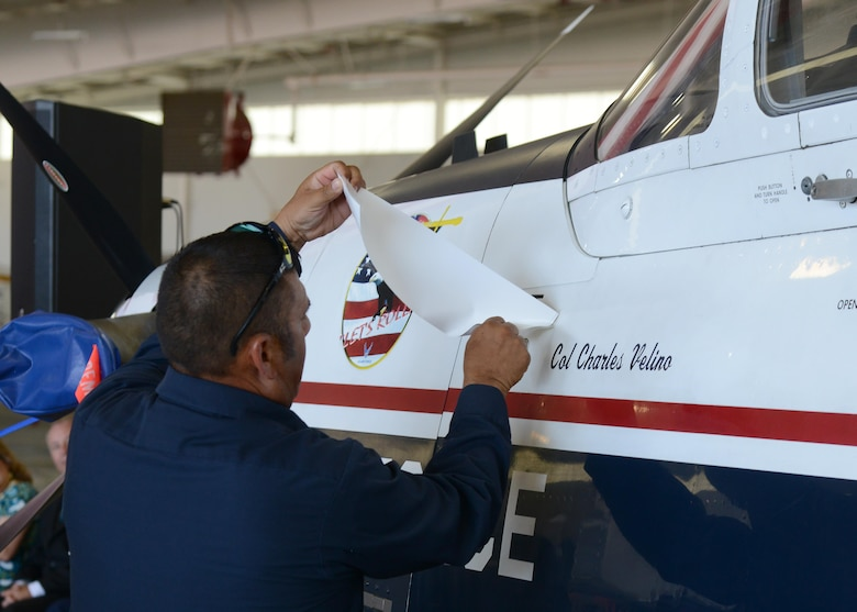 Newly appointed commander of the 47th Flying Training Wing, U.S. Air Force Col. Charles Velino, has his name revealed on the side of a T-6 Texan II during the wing's change of command ceremony at Laughlin Air Force Base, Tx., June 28, 2017.  The T-6 is the wing's primary training aircraft, which is flown by all undergraduate pilot students.