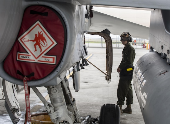 U.S. Marine Corps Lance Cpl. George Gonzalez, a powerline mechanic with Marine Fighter Attack Squadron (VMFA) 232, conducts maintenance on an F/A-18C Hornet during scheduled phase maintenance at Marine Corps Air Station Iwakuni, Japan, June 27, 2017. When aircraft go through phase maintenance, mechanics are able to perform in-depth maintenance to enhance the welfare of the aircraft. The definitive objective of the evaluation is to ensure mission accomplishment and safety of operations around the Indo-Asia Pacific region. (U.S. Marine Corps photo by Lance Cpl. Mason Roy)
