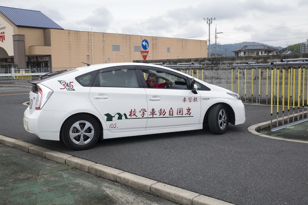 A Marine Corps Air Station Iwakuni resident backs out of a tight parking spot during a free driving course held for station residents in Iwakuni City, Japan, June 28, 2017. Twenty station residents were invited to take part in the short educational workshop aimed to decrease the number of traffic accidents and violations caused by station residents. (U.S. Marine Corps photo by Lance Cpl. Carlos Jimenez)