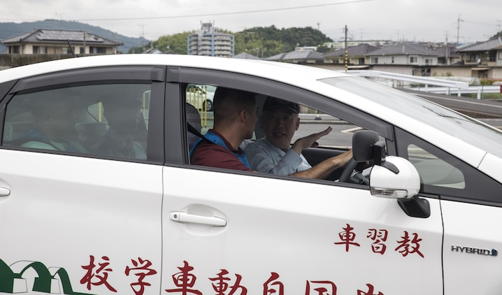 A Japanese driving instructor gives tips to a Marine Corps Air Station Iwakuni resident during a free driving class held for station residents in Iwakuni City, Japan, June 28, 2017. The station residents learned traffic rules and manners and drove in a live course with Japanese instructors and translators. Twenty station residents were invited to take part in the short, educational workshop aimed to decrease the number of traffic accidents and violations caused by air station residents. (U.S. Marine Corps photo by Lance Cpl. Carlos Jimenez)