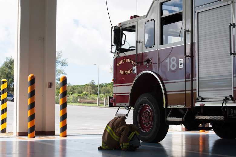 A U.S. Air Force 18th Civil Engineer Squadron firetruck sits ready for possible emergencies June 28, 2017, at Kadena Air Base, Japan. The 18th CES provides fire response services across Kadena, responding to inflight emergencies and domestic fires. (U.S Air Force photo by Senior Airman Quay Drawdy)