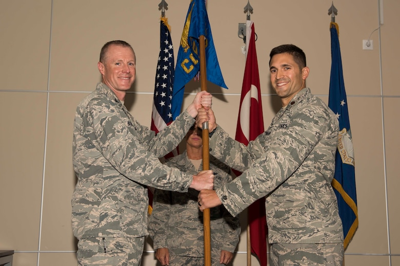 U.S. Air Force Maj. Michael Corrigan (right), 39th Contracting Squadron incoming commander, assumes command from Col. Todd Stratton, 39th Mission Support Group commander, June 28, 2017, at Incirlik Air Base, Turkey. A change of command ceremony is a tradition that represents a formal transfer of authority and responsibility from the outgoing commander to the incoming commander. (U.S. Air Force photo by Airman 1st Class Devin M. Rumbaugh)