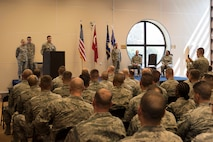 U.S. Air Force Maj. Michael Corrigan, 39th Contracting Squadron incoming commander, speaks to a group of airmen after assuming command, June 28, 2017, at Incirlik Air Base, Turkey. A change of command ceremony is a tradition that represents a formal transfer of authority and responsibility from the outgoing commander to the incoming commander. (U.S. Air Force photo by Airman 1st Class Devin M. Rumbaugh)