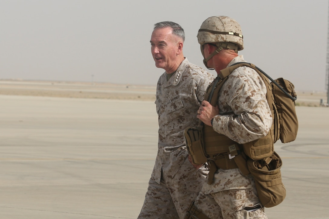 Gen. Joseph F. Dunford Jr., left, the chairman of the Joint Chiefs of Staff, speaks with Brig. Gen. Roger Turner, right, the commanding general of Task Force Southwest, at Bastion Airfield, Afghanistan, June 28, 2017. Dunford met with the unit's leadership to discuss their current train advise and assist mission to support Afghan National Defense and Security Forces in Helmand Province.  (U.S. Marine Corps photo by Sgt. Lucas Hopkins)