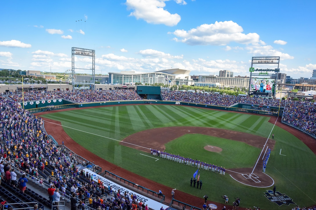 114th Fighter Wing pilots performed a fly over during the first game of the NCAA College World Series finals June 26, 2017, in Omaha, NE. They were then introduced and recognized at the top of the 6th inning of the game. (U.S. Air National Guard photo by Tech. Sgt. Luke Olson/Released)