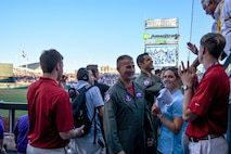 Lt. Col. Cory Kestel, 175th Fighter Squadron commander, and Capt. Tony Sullivan, 175th Fighter Squadron pilot, interacts with the crowd after being introduced and recognized at the top of the 6th inning of the first game of the NCAA College World Series finals June 26, 2017, in Omaha, NE. They performed a fly over at beginning of the game. (U.S. Air National Guard photo by Staff Sgt. Duane Duimstra/Released)