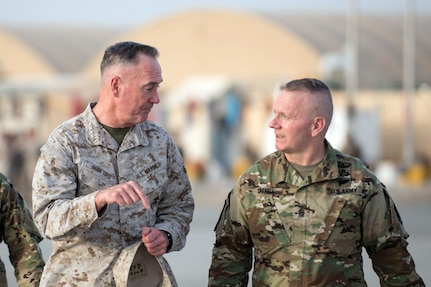 Marine Corps Gen. Joe Dunford, chairman of the Joint Chiefs of Staff, speaks with Army Command Sgt. Maj. John W. Troxell, senior enlisted advisor to the Chairman of the Joint Chiefs of Staff, after a visit to Train, Advise, Assist Command in Helmand Province, Afghanistan, June 28, 2017. Gen. Dunford traveled throughout the country meeting with U.S., coalition, and Afghan leaders. DoD photo by Army Sgt. James K. McCann