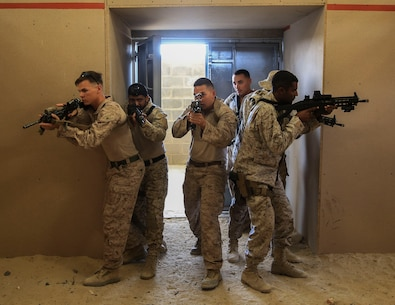 U.S. Marines with Charlie Company , 1st Battalion, 7th Marine Regiment, Special Purpose Marine Air-Ground Task Force-Crisis Response-Central Command and Saudi Arabian Naval Special Forces practice room clearing during a subject matter expert exchange in Saudi Arabia, May 15, 2017. The exchange proved to be an enhancing opportunity for both the U.S. and Saudi forces. Deploying U.S. Marines into the U.S. Central Command area of responsibility to conduct combined military training with our partner nations' security forces strengthens our vital relationships with partners in this important region. (U.S. Marine Corps photo by Cpl. Kyle McNan)