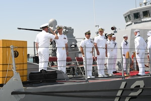 170617-N-XP344-055 MANAMA, Bahrain (June 27, 2017) From left, Lt. Cmdr. Timothy Yuhas, a native of Cave Creek, Arizona and former commanding officer of the Cyclone-class coastal patrol ship USS Thunderbolt (PC 12), salutes Lt. Cmdr. Michael T. McArawas, a native of Erie, Pennsylvania and current commanding officer, during a change of command ceremony held shipboard while pierside at Naval Support Activity Bahrain. Thunderbolt is one of 10 PCs forward deployed to Manama, Bahrain, whose mission is coastal patrol and interdiction surveillance. (U.S. Navy photo by Mass Communication Specialist 2nd Class Victoria Kinney)