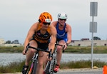 Point Mugu, Calif. (June 10, 2017) Army 1st Lt. Justine Emge is just ahead of Air Force Maj. Judith Coyle as they finish the 10-kilometer bike portion of the Armed Forces Triathlon. (U.S. Navy photo by Theresa Miller/Released)