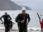 Point Mugu, Calif. (June 10, 2017) Navy Lt. Kyle Hooker and Navy Lt. Thomas Brown are first and second to complete the one-mile ocean swim at Point Mugu beach in the first leg of the Armed Forces Triathlon. (U.S. Navy photo by Theresa Miller/Released)