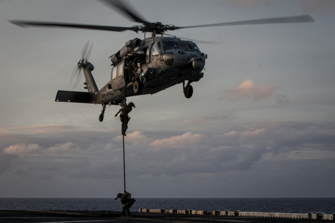 Marines with Force Reconnaissance Platoon, Maritime Raid Force, 31st Marine Expeditionary Unit rappel from a Navy MH-60S Seahawk helicopter during training aboard the amphibious assault ship USS Bonhomme Richard while underway in the Pacific Ocean, June 25, 2017. Marine Corps photo by Lance Cpl. Stormy Mendez
