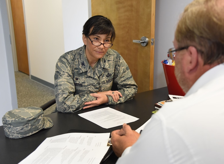 Sam Foster, 81st TRW information protection chief, briefs Col. Debra Lovette, 81st Training Wing commander, on information protection during a Wing Staff Agency orientation tour at the Sablich Center June 27, 2017, on Keesler Air Force Base, Miss. The tour familiarized Lovette with the Wing Staff Agency mission, operations and personnel. (U.S. Air Force photo by Kemberly Groue)