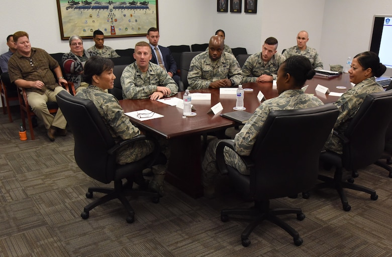 Col. Debra Lovette, 81st Training Wing commander, receives a briefing from the Judge Advocate Office during a Wing Staff Agency orientation tour at the Sablich Center June 27, 2017, on Keesler Air Force Base, Miss. The tour familiarized Lovette with the Wing Staff Agency mission, operations and personnel. (U.S. Air Force photo by Kemberly Groue)