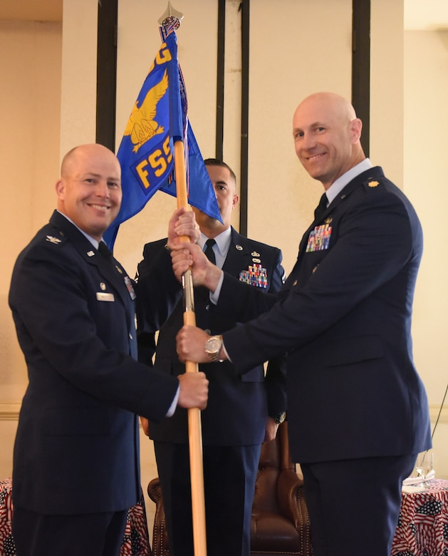 Col. Richard Mathews, left, 628th Mission Support Group commander, passes the 628th Force Support Squadron guideon to incoming commander, Maj. William Parker during the 628th FSS change of command ceremony, June 29, 2017 at Joint Base Charleston, SC. Parker came to Charleston from Osan Air Force Base, Republic of Korea where he commanded the 51st FSS.