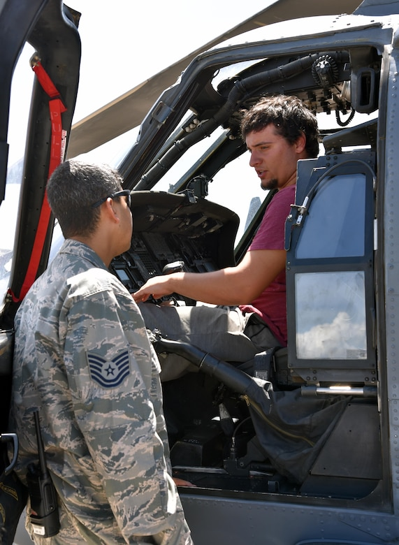 Tech. Sgt. Kristopher Castillo, left, 920th Aircraft Maintenance Squadron HH-60G Pave Hawk crew chief, talks with an Eagle Scout about the Pave Hawk and the 920th Rescue Wing mission during a tour of the unit June 23, 2017 on the flight line at Patrick Air Force Base, Florida. The scouts accompanied Maj. Gen. Vincent Mancuso, Air Staff deputy director, Pentagon, during a tour of the wing. (U.S. Air Force photo/Tech. Sgt. Lindsey Maurice)