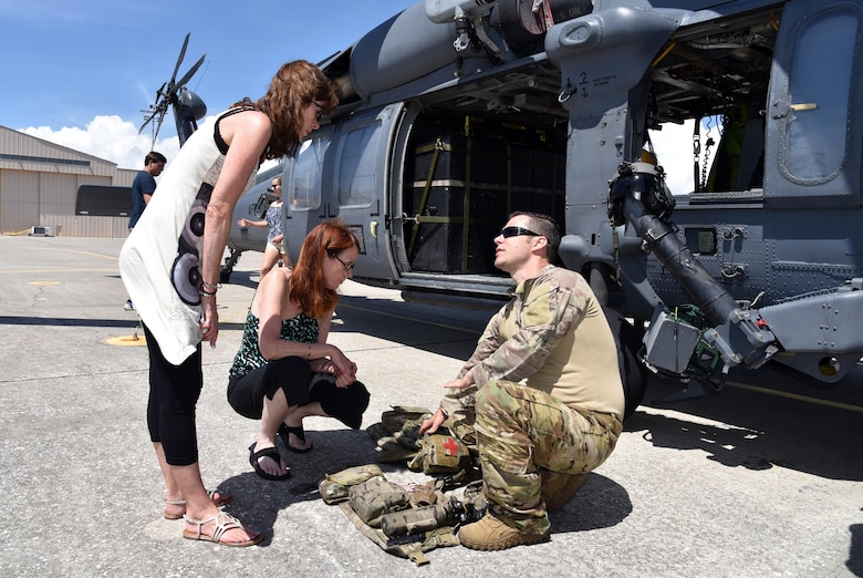 Staff Sgt. Joseph Montero, right, 301st Rescue Squadron special missions aviator, explains some of the equipment he uses during missions aboard the HH-60G Pave Hawk helicopter to tour guests June 23, 2017 on the flight line at Patrick Air Force Base, Florida. The guests accompanied Maj. Gen. Vincent Mancuso, Air Staff deputy director, Pentagon, while he toured the 920th Rescue Wing. (U.S. Air Force photo/Tech. Sgt. Lindsey Maurice)
