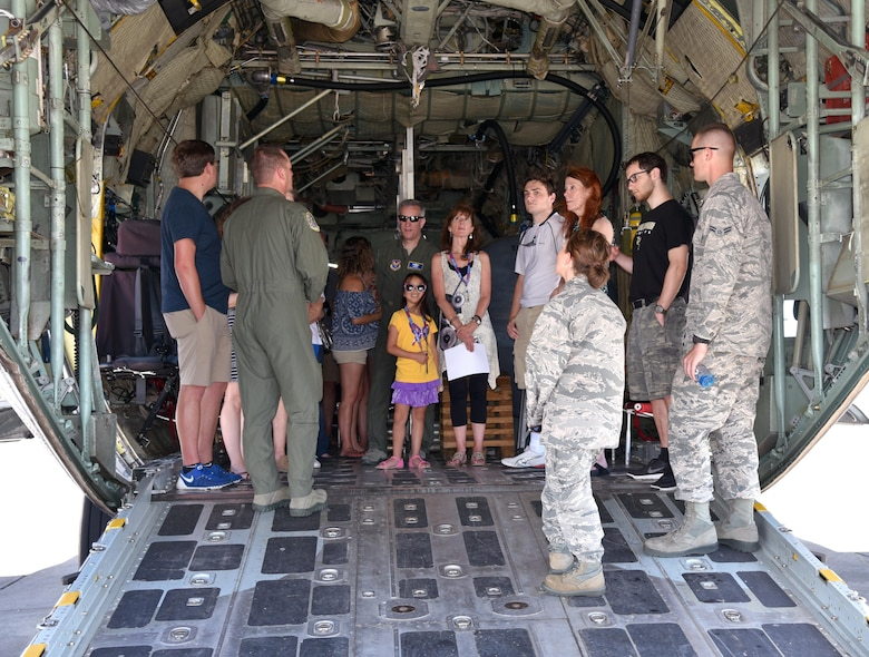 Aviators and maintainers of the 920th Rescue Wing discuss the capabilities of the HC-130 Hercules and its contributions to the rescue mission to Maj. Gen. Vincent Mancuso, middle, Air Staff deputy director, Pentagon, and his guests June 23, 2017 in the back of an HC-130 on the Patrick Air Force Base, Florida, flight line. During the general's visit of the 920th Rescue Wing, he received a mission briefing, toured the 308th Rescue Squadron Guardian Angels facility and visited with HC-130 and HH-60G aviators and maintainers. (U.S. Air Force photo/Tech. Sgt. Lindsey Maurice)
