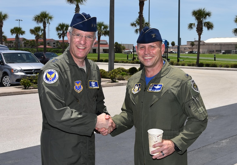 Col. Kurt Matthews, right, 920th Rescue Wing commander, bids farewell to Maj. Gen. Vincent Mancuso, right, Air Staff deputy director, Pentagon, June 23, 2017 outside the dining facility at Patrick Air Force Base, Florida. The general spent the day with the 920th Rescue Wing touring the 308th Rescue Squadron Guardian Angels facility and visiting with HC-130 Hercules and HH-60G Pave Hawk aviators and maintainers. (U.S. Air Force photo/Tech. Sgt. Lindsey Maurice)