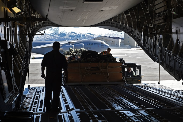 Airmen load cargo onto a C-17 Globemaster III at Joint Base Elmendorf-Richardson, Alaska, April 18, 2017. The cargo was later dropped during a training mission at the Malemute Drop Zone at JBER. (U.S. Air Force photo by Airman 1st Class Valerie Monroy)