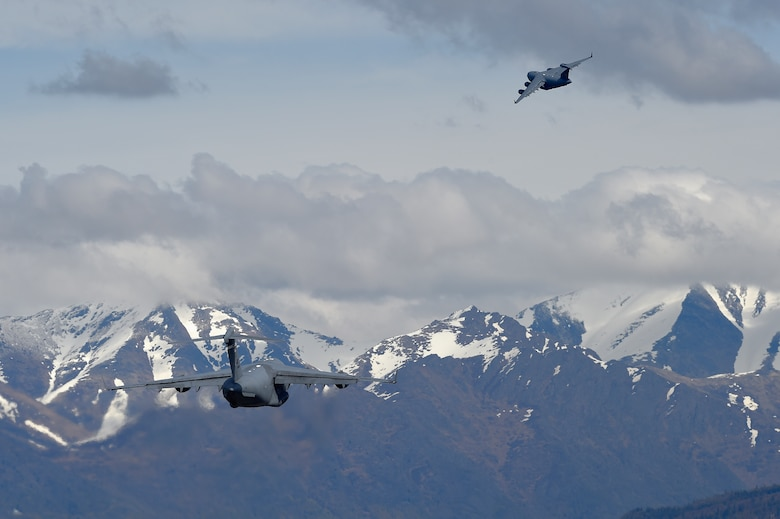 Two U.S. Air Force C-17 Globemaster IIIs take off from Joint Base Elmendorf-Richardson during Red Flag Alaska 16-1, May 10, 2016. Red Flag Alaska 16-1 provides joint offensive, counter-air, interdiction, close air support, and large force employment training in a simulated combat environment. (U.S. Air Force photo/Alejandro Pena)