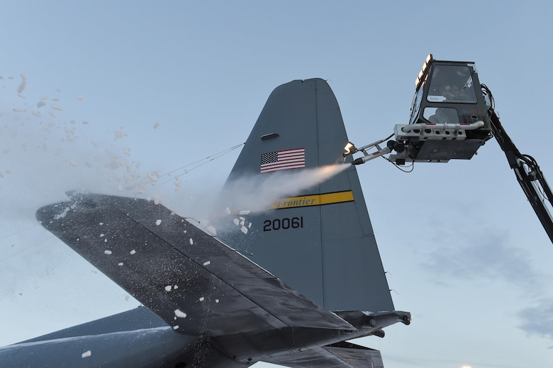 U.S. Air Force Airmen assigned to the 732nd Air Mobility Squadron deice an Alaska Air National Guard C-130H Hercules belonging to the 144th Airlift Squadron on Joint Base Elmendorf-Richardson, Alaska, Dec. 8, 2015. Deicing keeps aircraft operational despite the harsh Alaska winters by removing heavy layers of snow, ice and frost that could adversely affect flight. (U.S. Air Force photo/Alejandro Pena)