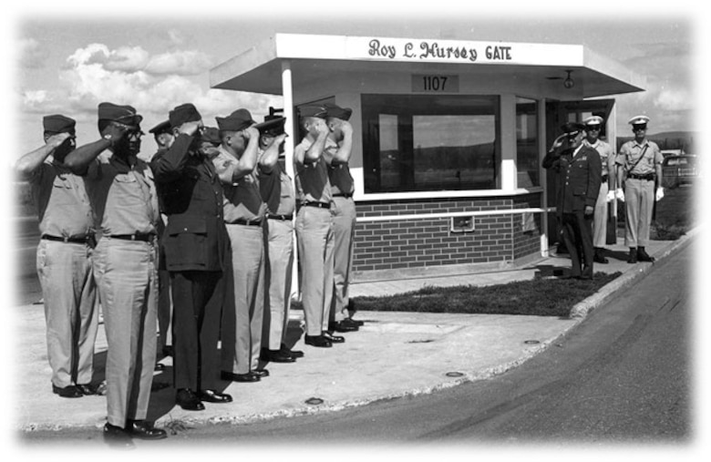 U.S. Air Force Airmen commemorate the opening of Hursey Gate by rendering the appropriate customs and courtesies circa 1965 at Eielson Air Force Base, Alaska. Hursey Gate has gone through many upgrades in the following years, but the namesake has always remained.    (U.S. Air Force courtesy photo)