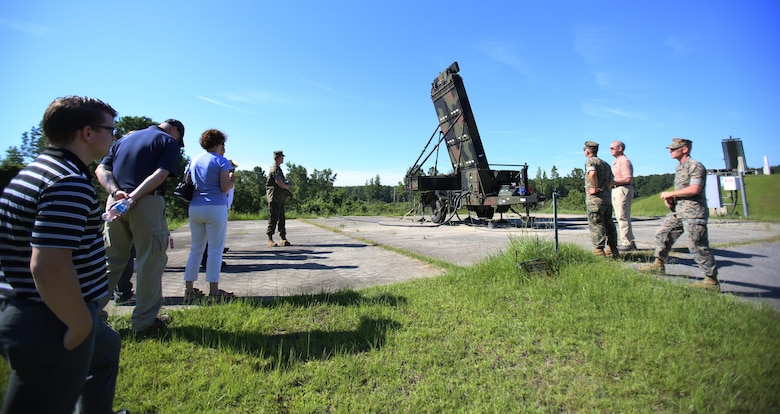 Marines assigned to Marine Air Control Squadron 2 showcase the Ground/Air Task Oriented Radar to personnel from Program Executive Officer Land Systems aboard Marine Corps Air Station Cherry Point, N.C., June 28, 2017. The Marines demonstrated how the G/ATOR integrates with two other new systems, the Common Aviation Command and Control System and the Composite Tracking Network, to provide faster and more accurate data to Marine Air-Ground Task Force commanders, improving their situational awareness and decision making ability. MACS-2 is part of Marine Air Control Group 28, 2nd Marine Aircraft Wing. (U.S. Marine Corps Photo by Pfc. Skyler Pumphret/ Released)