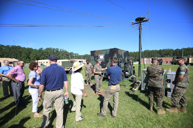 Marines assigned to Marine Air Control Squadron 2 showcase the Composite Tracking Network to personnel from Program Executive Officer Land Systems aboard Marine Corps Air Station Cherry Point, N.C., June 28, 2017. The CTN interfaces with the Ground/Air Task Oriented Radar and the Common Aviation Command and Control System to establish a wider radar range and more accurate data than previous systems. The ability of the three systems to integrate with one another provides faster and more accurate data to Marine Air-Ground Task Force commanders, allowing them to maintain better situational awareness, and improving their decision making ability. MACS-2 is assigned to Marine Air Control Group 28, 2nd Marine Aircraft Wing. (U.S. Marine Corps Photo by Pfc. Skyler Pumphret/ Released)