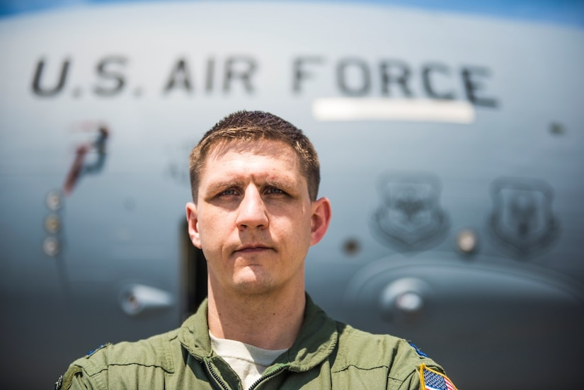 Editors Note: This album is one of several products being shared in 2017 by the Joint Base Charleston Public Affairs Office in honor of the 70th Anniversary of the Air Force and those who selflessly have and continue to serve our nation.  Capt. Kevin Summerbell, 15th Airlift Squadron, 437th Airlift Wing, stands in front of the entrance to a C-17 Globemaster III on the flightline at Joint Base Charleston April 4, 2017. Summerbell was enlisted in the Army as an infantryman prior to commissioning in the Air Force. He deployed to Iraq twice during his time in the Army and received a Purple Heart for his wounds and courage on the battlefield. Summerbell earned his bachelor's degree, attended ROTC and completed flight school, then became a C-17 pilot at the 437th AW.
