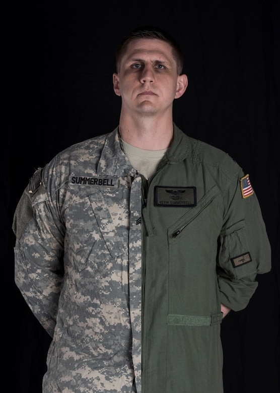 Editors Note: This album is one of several products being shared in 2017 by the Joint Base Charleston Public Affairs Office in honor of the 70th Anniversary of the Air Force and those who selflessly have and continue to serve our nation.  Capt. Kevin Summerbell, 15th Airlift Squadron, 437th Airlift Wing, poses in both his Army and Air Force uniforms to combine and symbolize his transition from one branch to the other April 4, 2017. Summerbell was enlisted in the Army as an infantryman prior to commissioning in the Air Force. He deployed to Iraq twice during his time in the Army and received a Purple Heart for his wounds and courage on the battlefield. Summerbell earned his bachelor's degree, attended ROTC and completed flight school, then became a C-17 pilot at the 437th AW.