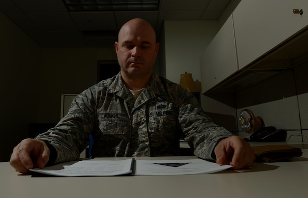 Tech. Sgt. John Major, 62nd Airlift Wing manpower and organization NCOIC, reviews a manpower document June 29, 2017, at Joint Base Lewis-McChord, Wash. The 62nd Airlift Wing manpower and organization office advises Team McChord leadership on issues pertaining to wartime and peacetime manpower resources, organization structure, productivity and performance management. (U.S. Air Force photo/Senior Airman Divine Cox)