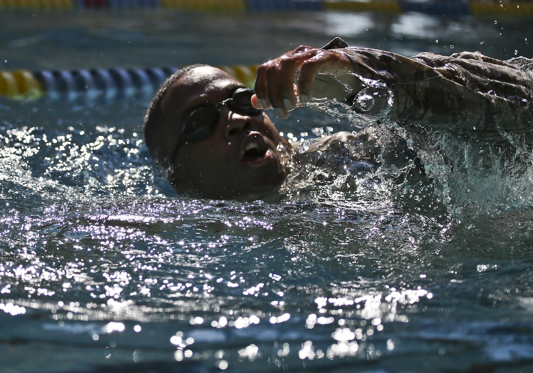 U.S. Air Force Staff Sgt. Rafiq Pickett from the New Jersey Air National Guard's 108th Security Forces Squadron swims the 100 meter challenge during a German Armed Forces Badge for Military Proficiency test at Joint Base McGuire-Dix-Lakehurst, N.J., June 13, 2017. The test included an 1x10-meter sprint, flex arm hang, 1,000 meter run, 100 meter swim in Military Uniform, marksmanship, and a timed foot march. (U.S. Air National Guard photo by Master Sgt. Matt Hecht/Released)