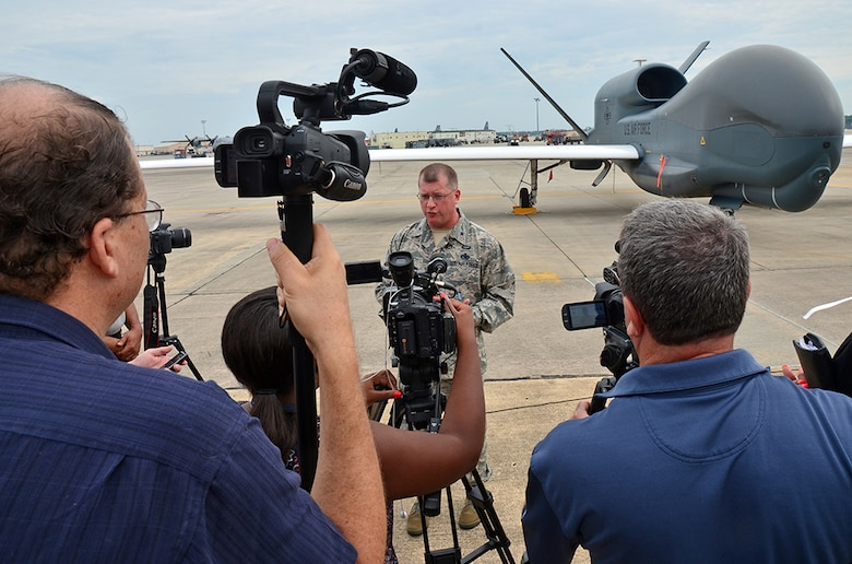 Brig. Gen. John Kubinec, Warner Robins Air Logistics Complex commander, speaks with local media June 29, following a special ribbon cutting ceremony which signaled the early completion of work on the first RQ-4 Global Hawk at Robins Air Force Base, Ga. The base is the first and only installation to have a building-based Launch and Recovery Element, allowing the aircraft to take off and land from this location. This is also the first time a Global Hawk has flown into an Air Force air logistics complex. Team Robins maintenance professionals meticulously painted the aircraft to prevent corrosion. (U.S. Air Force photo/TECH. SGT. KELLY GOONAN)