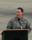 Col. Sarah Christ, 78th Air Base Wing vice commander, addresses a crowd of people during a ceremony marking the early completion of work on an RQ-4 Global Hawk. Robins Air Force Base is the first and only installation to have a building-based Launch and Recovery Element, allowing the aircraft to take off and land from this location. This is also the first time a Global Hawk has flown into an Air Force air logistics complex. Warner Robins Air Logistics Complex maintenance professionals meticulously painted the aircraft to prevent corrosion. While a programmed depot maintenance requirement for Global Hawk has not been established, the Air Force recognizes that having an organic maintenance capability for Global Hawk enhances our ability to manage the fleet and keep this resource flying. (U.S. Air Force photo/ED ASPERA)