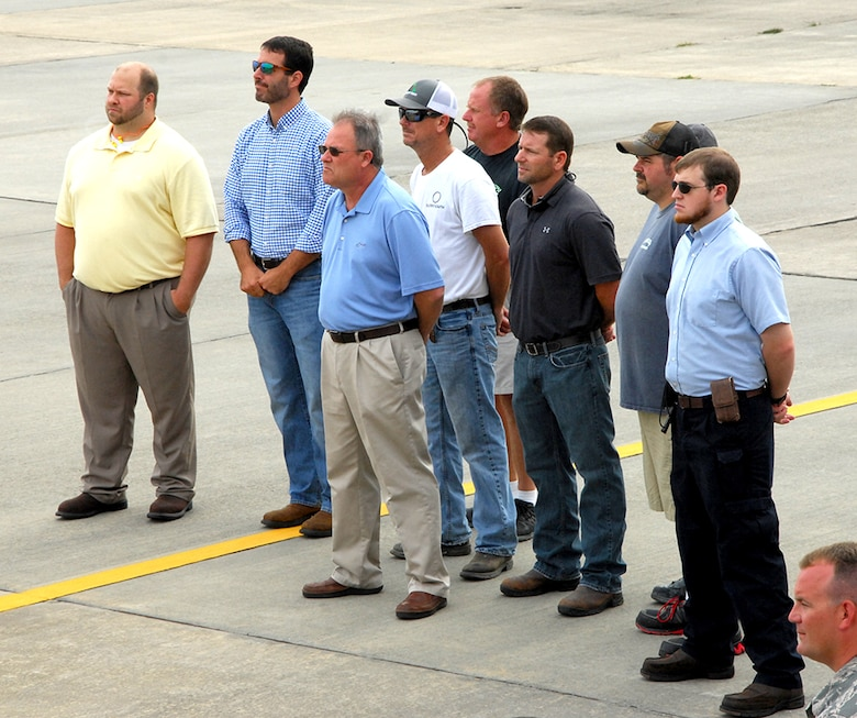 A group of Team Robins employees attend a June 29 ceremony marking the end of work done to an RQ-4 Global Hawk at the Warner Robins Air Logistics Complex. Robins Air Force Base is the first and only installation to have a building-based Launch and Recovery Element, allowing the aircraft to take off and land from this location. This is also the first time a Global Hawk has flown into an Air Force air logistics complex. Warner Robins Air Logistics Complex maintenance professionals meticulously painted the aircraft to prevent corrosion. While a programmed depot maintenance requirement for Global Hawk has not been established, the Air Force recognizes that having an organic maintenance capability for Global Hawk enhances our ability to manage the fleet and keep this resource flying. (U.S. Air Force photo/ED ASPERA