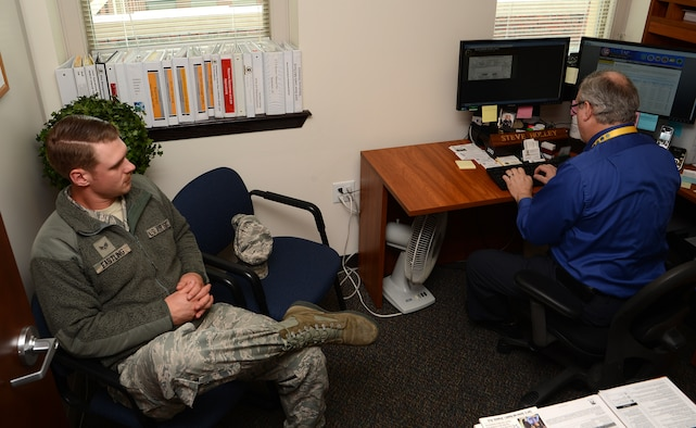 Senior Airman Ethan Eastling, 62nd Aircraft Maintenance Squadron aircraft maintainer, receives career counseling from Steve Holley, Service Member for Life Transition Assistance Program unit outreach team member, June 27, 2017, at Joint Base Lewis-McChord, Wash.  The SFL TAP provides relevant and practical tools and services to help transitioning service members reintegrate into the civilian workforce. (U.S. Air Force photo/Senior Airman Jacob Jimenez)