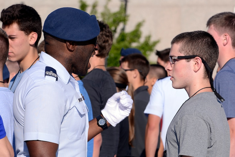 A cadet at the U.S. Air Force Academy encourages a basic cadet to pay attention to instructions June 29, 2017 at the start of Basic Cadet Training. (U.S. Air Force photo/Mike Kaplan)
