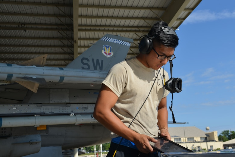 U.S. Air Force Airman 1st Class Robert Owens, 20th Aircraft Maintenance Squadron, Shooters Aircraft Maintenance Unit tactical aircraft maintainer, refers to his tablet prior to marshalling a 55th Fighter Squadron (FS) F-16CM Fighting Falcon at Shaw Air Force Base, S.C., June 26, 2017. Pilots, maintainers and intelligence Airmen assigned to the 55th FS participate in Red Flag exercises at Nellis Air Force Base, Nev., to gain experience and maintain combat readiness for deployments. (U.S. Air Force photo by Airman 1st Class Destinee Sweeney)