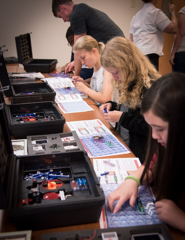 170619-N-GB257-001 CHARLESTON; S.C. (June 19, 2017)  Students build robots at the fifth annual Cyber Security Summer Camp hosted by Space and Naval Warfare Systems Center (SSC) Atlantic at Burke High School June 19-23. More than 30 SSC Atlantic employees volunteered along with others from Trident Technical College, instructing more than 135 students from Charleston, Berkeley and Dorchester county school districts. (U.S. Navy photo by Joe Bullinger/Released)