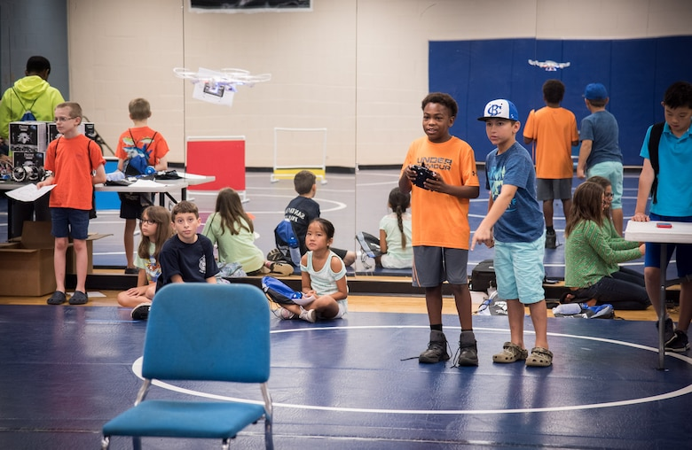 Campers remotely control a drone at the Space and Naval Warfare Systems Center (SSC) Atlantic-hosted -fifth annual Cyber Security Summer Camp at Burke High School June 19-23. More than 30 SSC Atlantic employees volunteered along with others from Trident Technical College, instructing more than 135 students from Charleston, Berkeley and Dorchester county school districts.