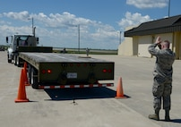 Staff Sgt. Brenton Gibbs, 5th Munitions Squadron munitions inspector, guides a truck through cones during Global Strike Challenge at Minot Air Force Base, N.D., June 19, 2017. The vehicle rodeo was part of many events during Global Strike Challenge. (U.S. Air Force Photo by Staff Sgt. Chad Trujillo)